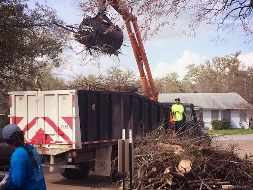 Nelson loading dumpster.jpg