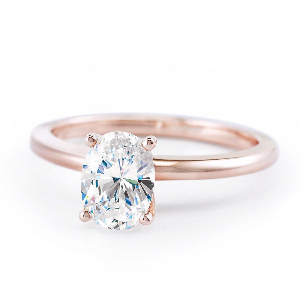 Oval diamond engagement ring.