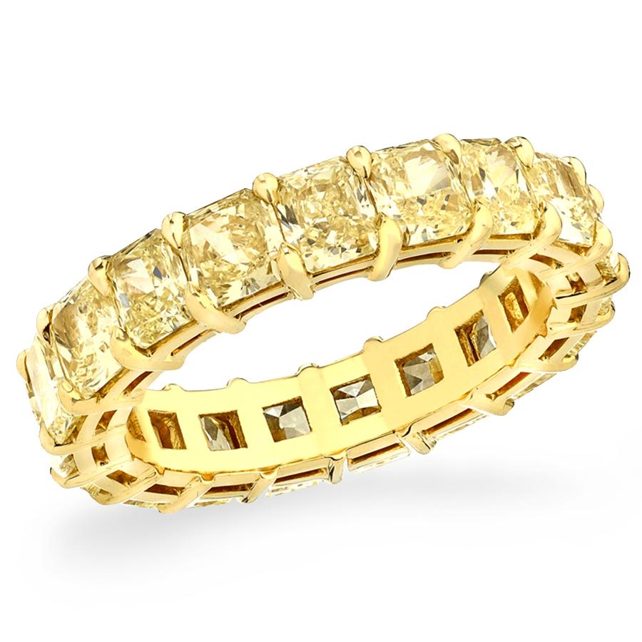 Yellow Diamond Eternity Band: 19 fancy yellow diamonds, 4.64 carat total weight, 18K yellow gold.