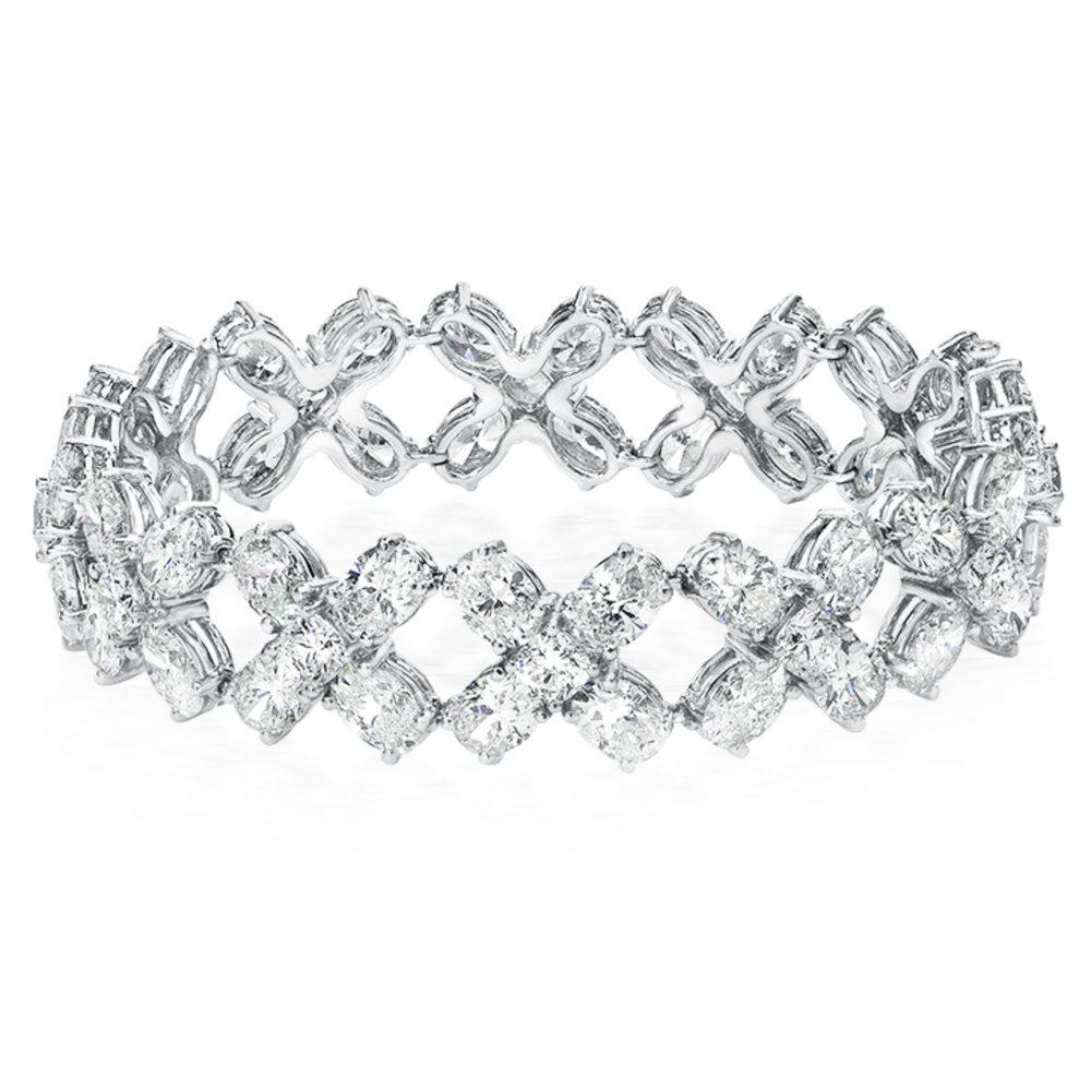 Beautiful oval and cushion diamond bracelet, handmade in platinum with 40 carats of fine diamonds.