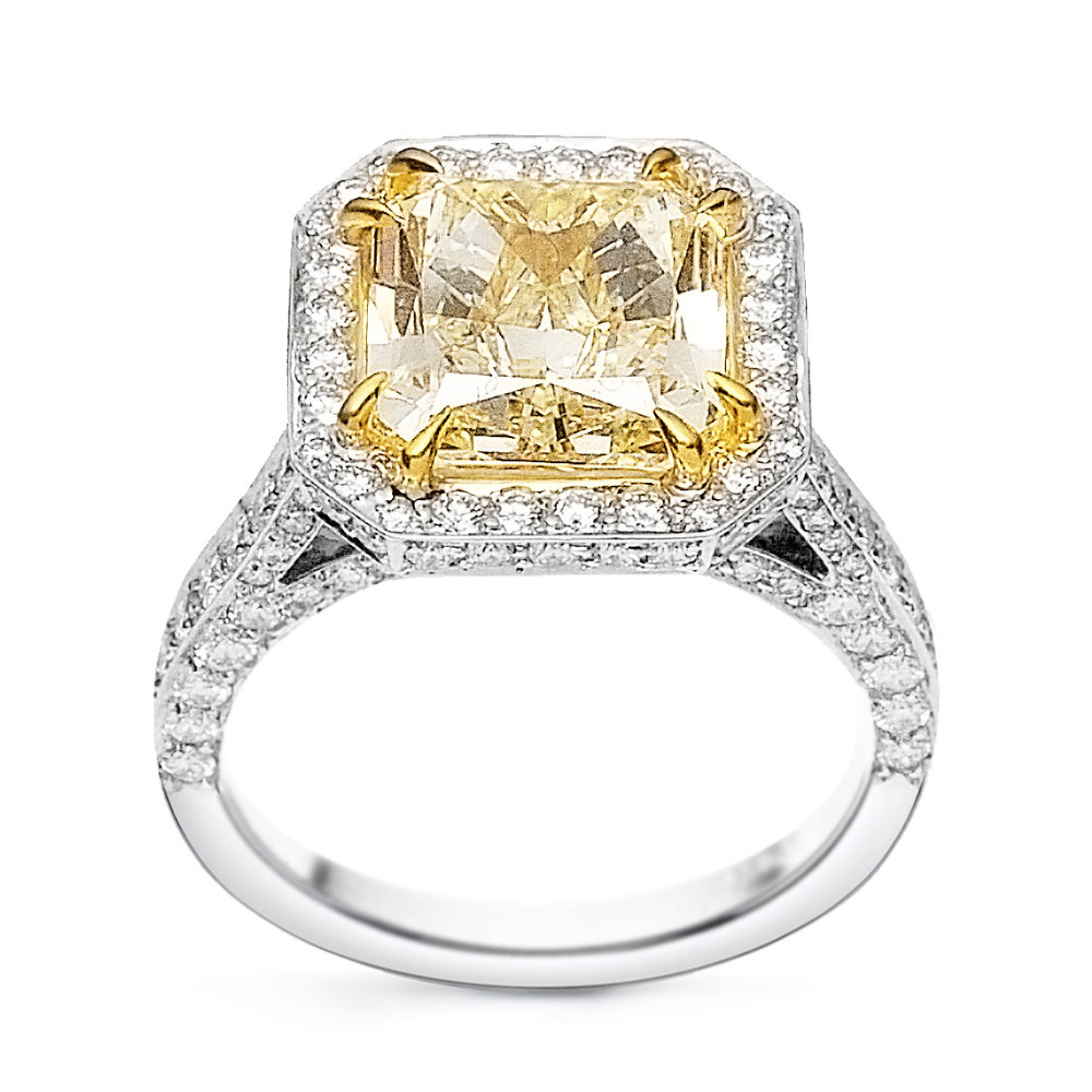 Radiant cut fancy yellow diamond ring, 18K yellow and white gold or platinum.