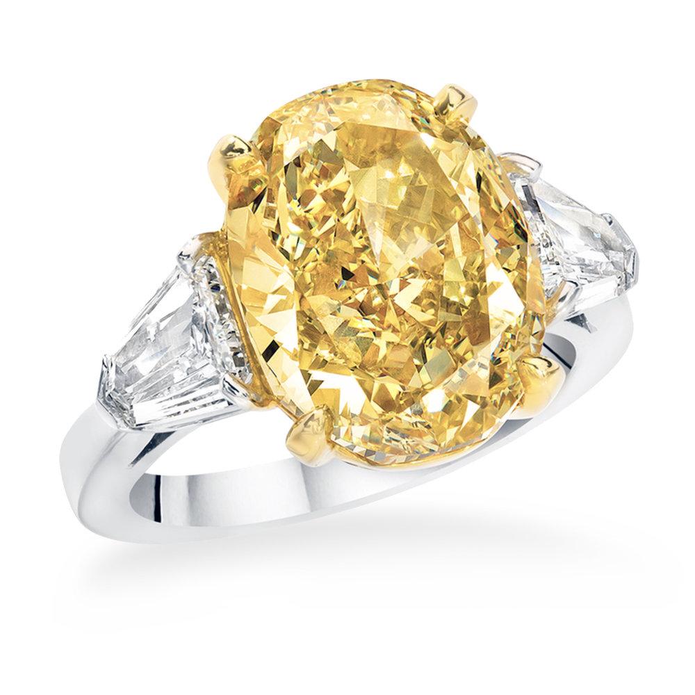 Beautiful 8 carat oval fancy yellow diamond, set in a handmade platinum ring with two 1 carat fine white diamonds.