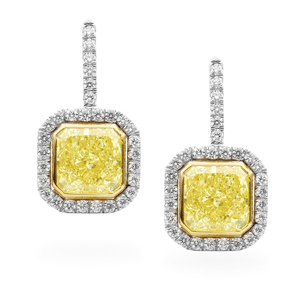 Radiant cut fancy yellow diamond earrings, set in 18K white and yellow gold.
