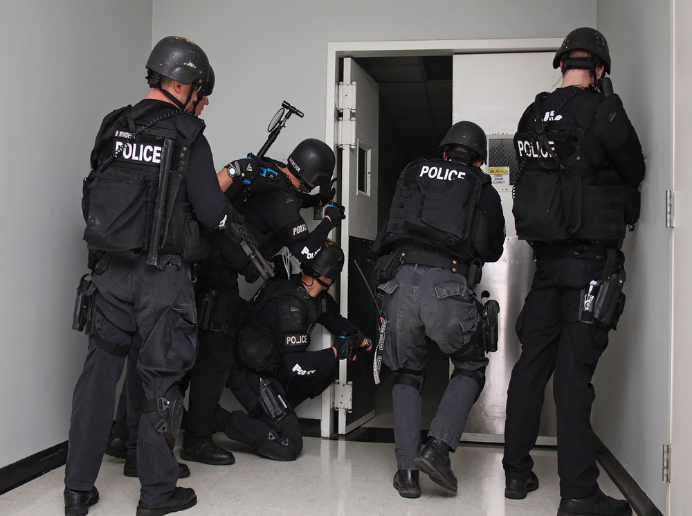 Police officers performing mass shooter training.