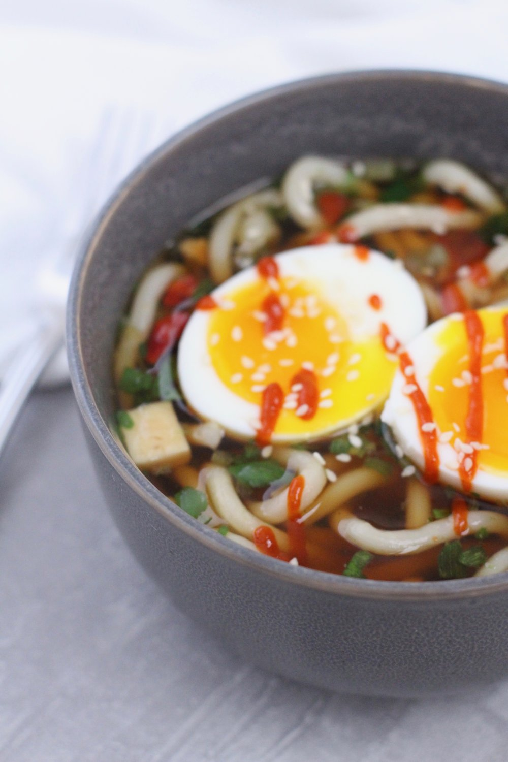 Instant Pot soft boiled eggs over ramen noodle soup with runny yolks.jpg