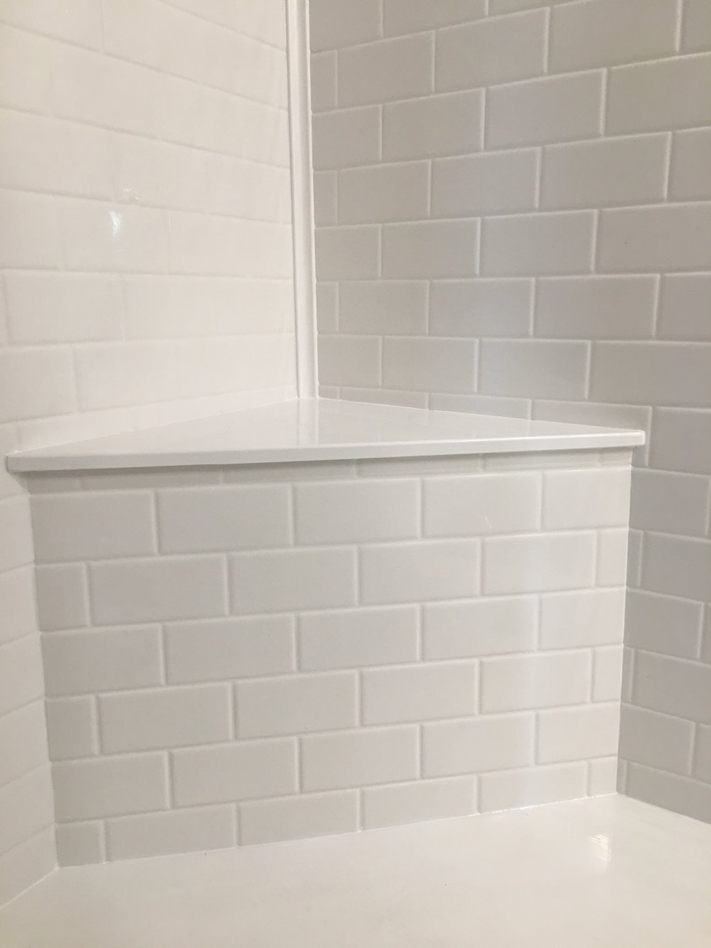 Subway Tile Texture - Add the look of subway tile to your shower without the worry of grout lines failing in the future.  Subway tile texture is available in every color we make can add a beautiful accent to your shower or