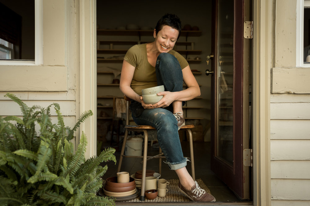 Christie in the doorway of her backyard studio in Bellevue, Kentucky. Since moving clay production, this space has become a plaster mold-making studio.