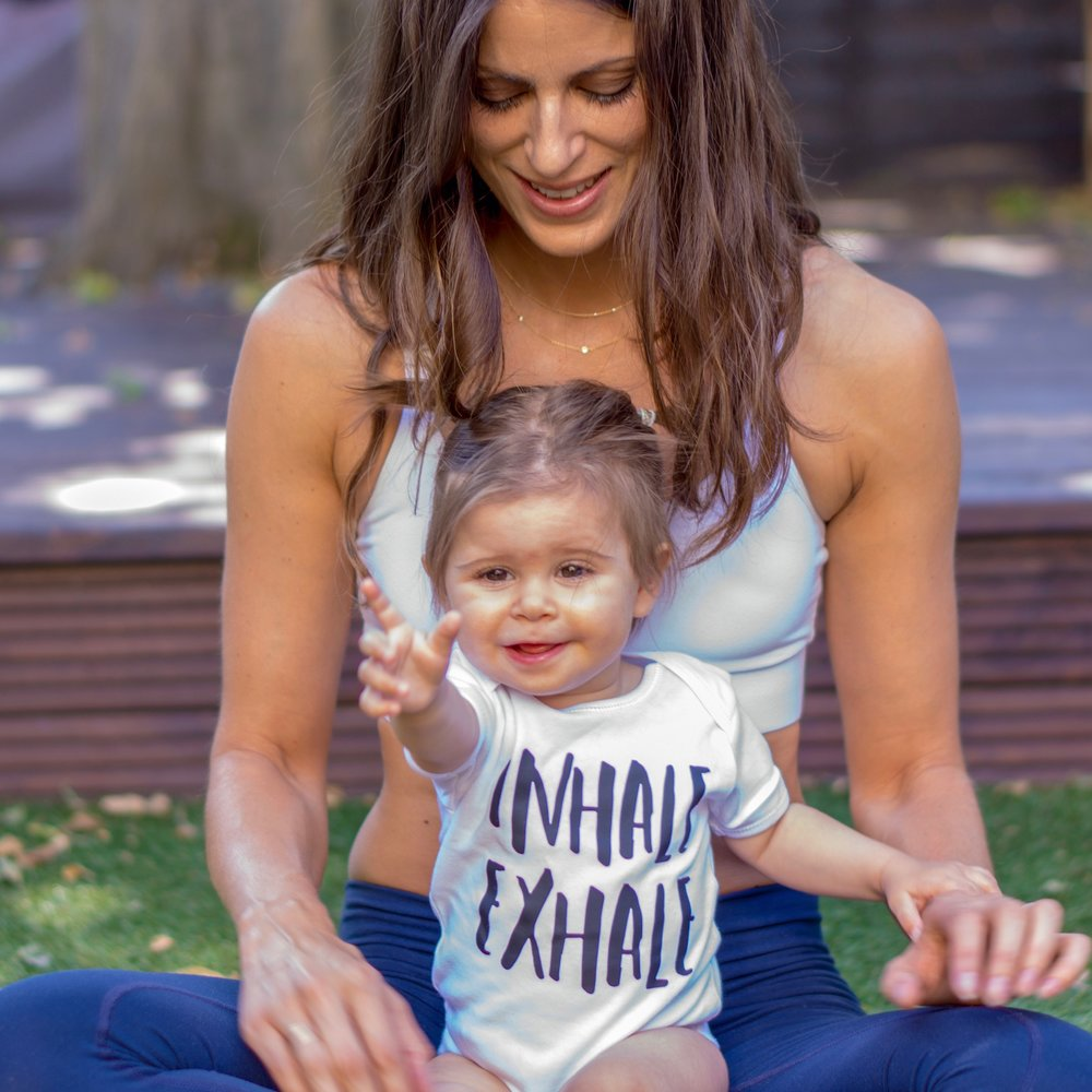 Hannah Barret ie Yoga Girl London with her daughter.
