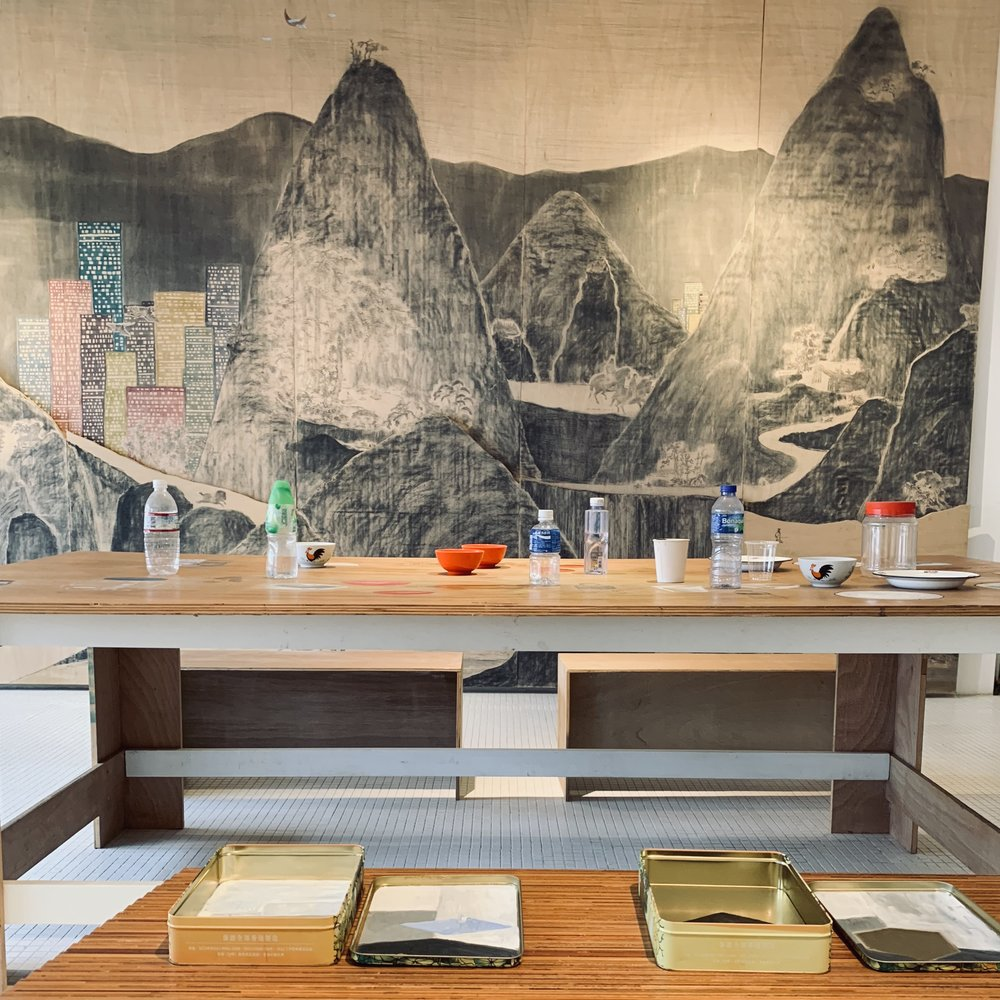 William Lim's table sits in front of a painting by Lam Tung Pang.