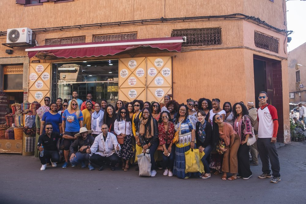 Group picture with our group members, tour guides and spice shop employees.