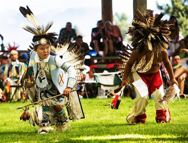 Photo from Wallowa County Chieftain:  Lewis Allen, a Nez Perce of Lapwaii, Idaho, competes with another dancer in the Junior Boy's Traditional dance at the 2018 Tamkaliks.