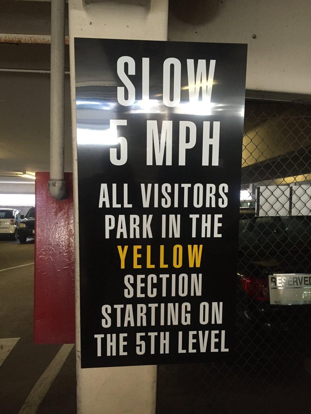 Slow 5 MPH Parking Sign