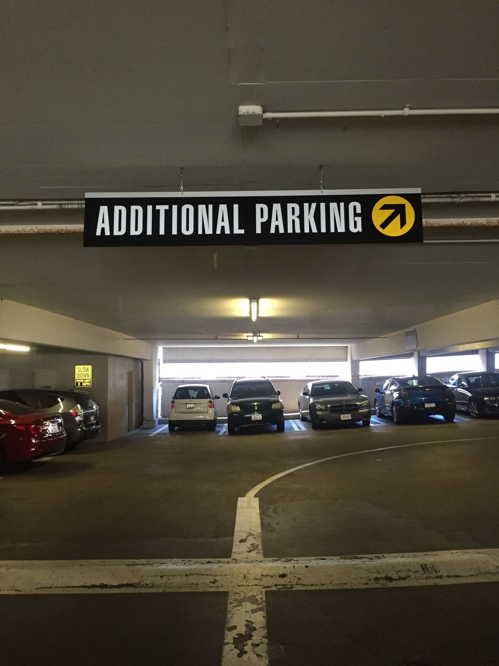Suspended Directional Parking Sign