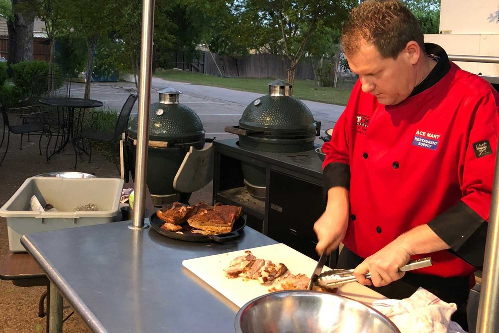 Chef Charles cutting meat
