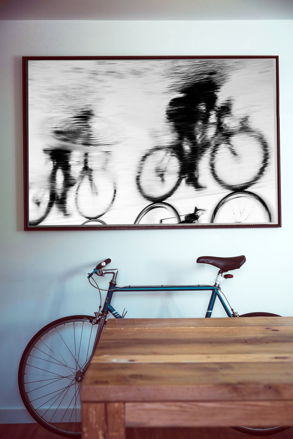 Reflected cyclists photographic print by Andrew Lever