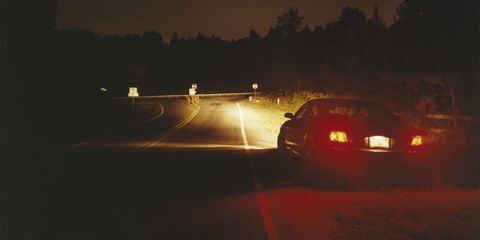 show don't tell break lights on road scary story thriller