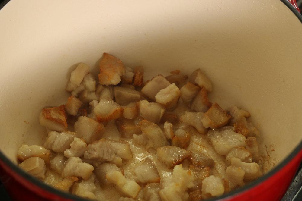 Fry pork belly until you get crispy browned edges.