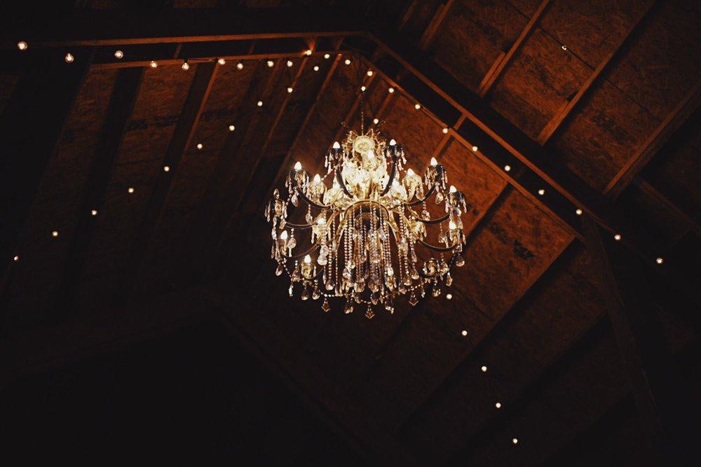 wedding-barn-chandlier-stringed-lights.jpg
