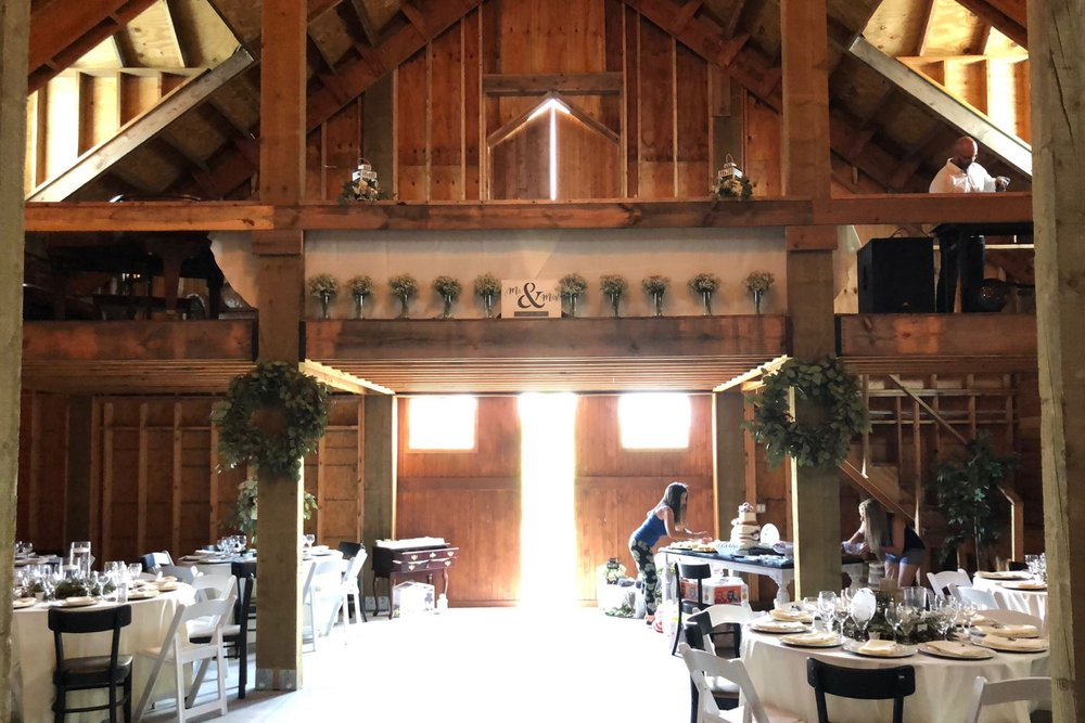 A view of the interior of the Barn Stall Winery & Wedding Barn. The 12x10 foot loft and beautiful lighting from the barn's many windows.