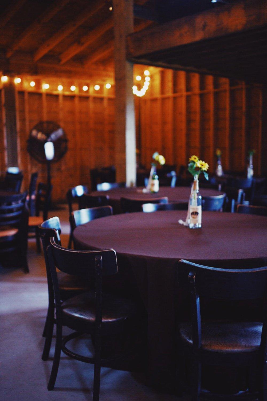 wedding-barn-inside-tablecloths-centerpieces.jpg