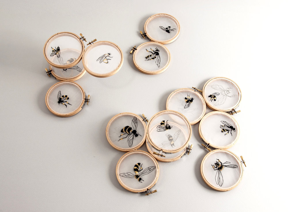 Spoonful of Honey   20 x35 x3  embroidery hoops, organza, thread  2012  Many hours were spent in hand-embroidering these bees, but they pale compared to the entire life times' work of three bees in producing a spoonful of honey.