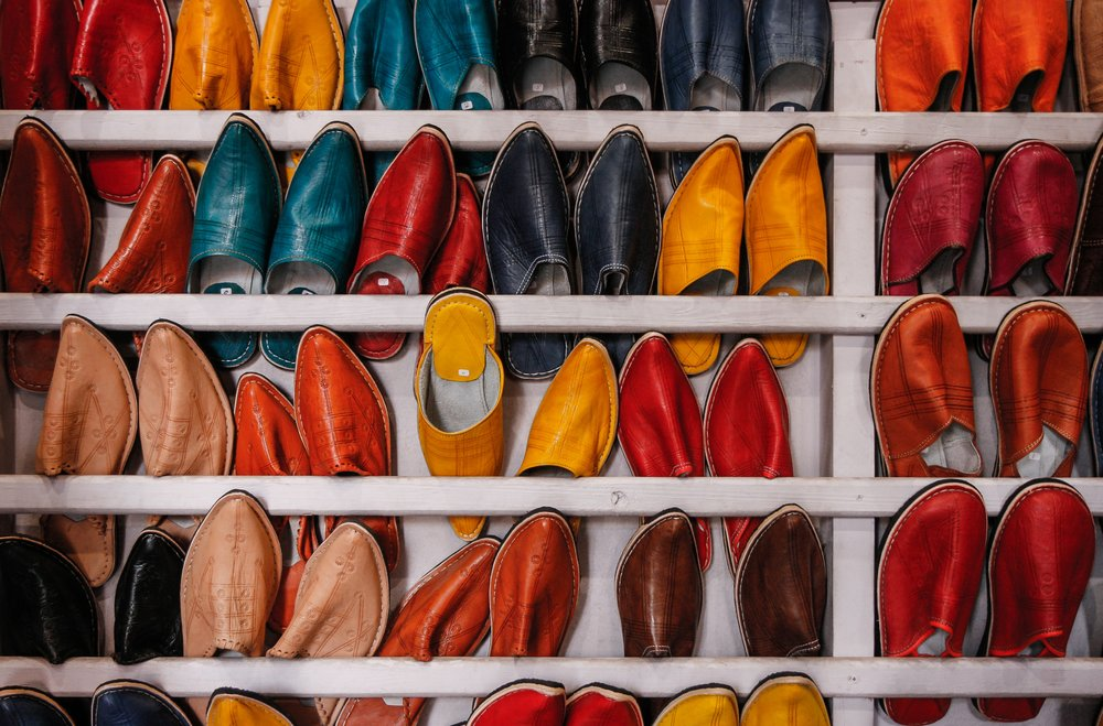 Colourful leather slippers is an example of strong craftsmanship in Morocco. Photo by  Martin Adams  on  Unsplash