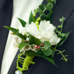 Rose with greenery Boutonniere: $25