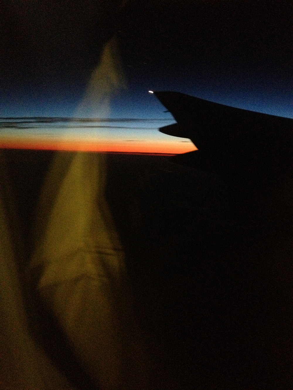 Sunset behind the port wing of a 777-200 over Nova Scotia