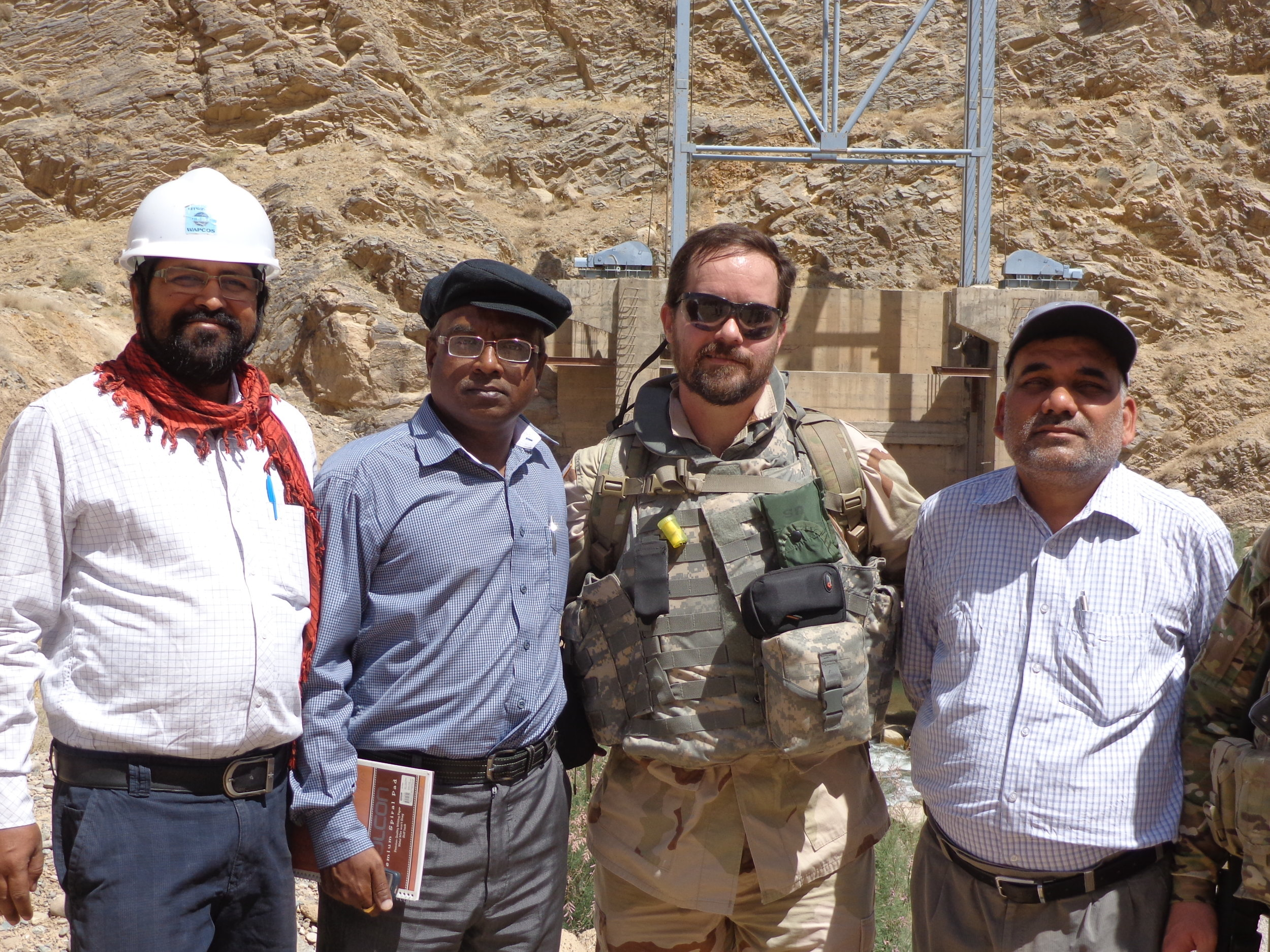 My hosts and I, Project Manager on my right, diversion tunnel for the river in the background