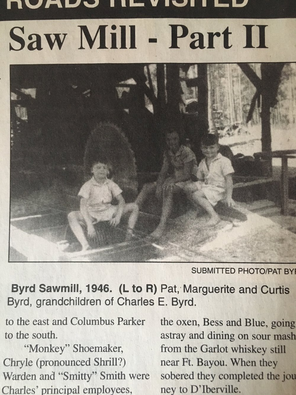 Aunt Maggie, Uncle Curt, and Uncle Pat at the sawmill in 46, Dad must have been in the house somewhere.