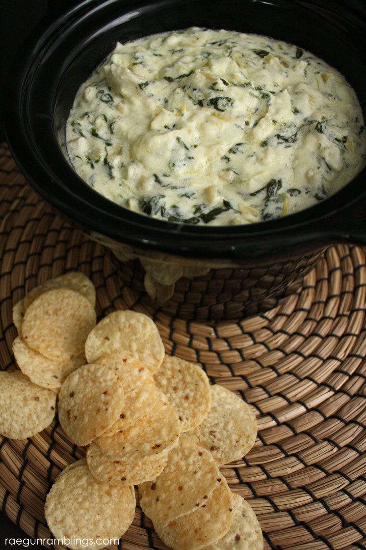 Spinach Artichoke Dip - IngredientsCrock Pot8 oz package of cream cheese16 oz sour cream1 stick (1/2 C) butter10 oz frozen chopped spinach, thawed and squeezed to remove excess liquid14 oz jar of Artichoke Hearts, chopped4oz diced chilies, drained1 1/2 C shredded Parmesan cheese1/4 C grated Romano cheese1 TBS chopped garlicInstructionsCombine everything in crock pot and allow to heat through (about 40 minutes).