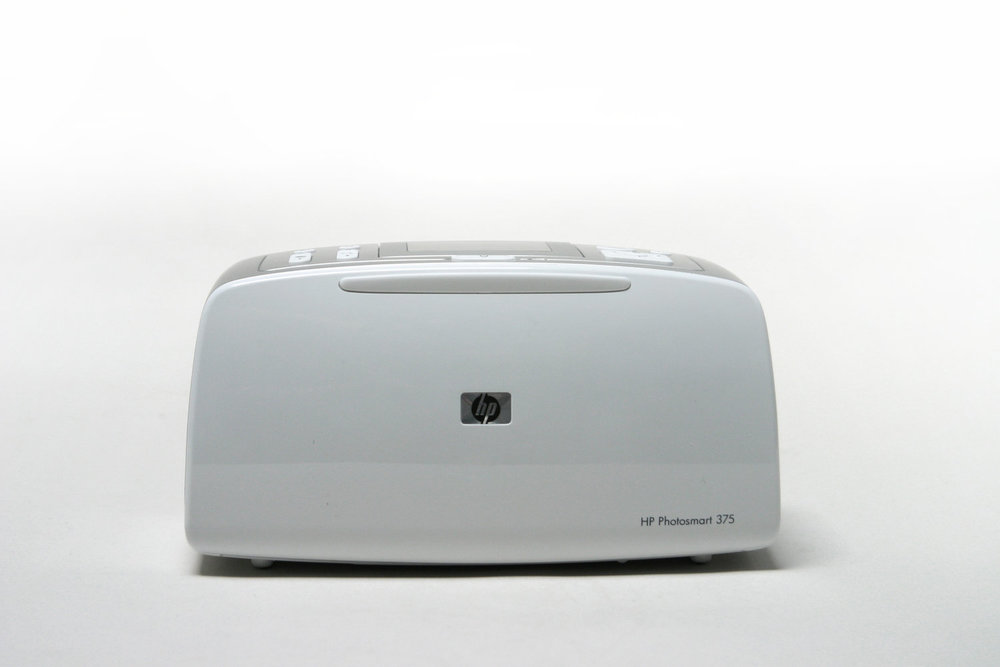 HP Photosmart 475 Printer - Completed 2004, as a Designer for SmartHP asked for a contemporary, clean and geometric language for a brand new category of very small portable printers.