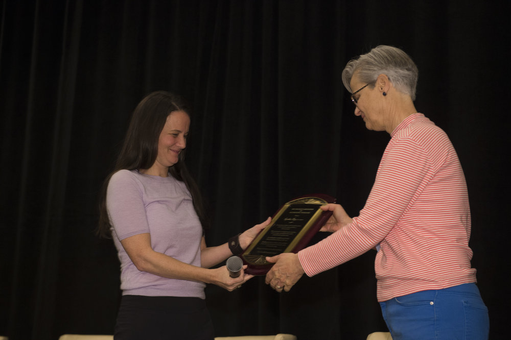 Heather Wright, ND (left), presents award to Cynthia Bye, ND, FABNO (right)