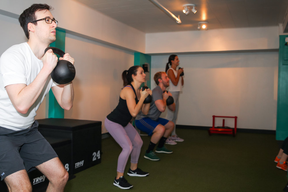 Semi-Private training - Semi-Private Training combines the community feel of our classes, with the personalized attention & customization of personal training. Our semi-private sessions will include up to 5 clients at a time, working off their own specific program, at their own pace. This is a great option if you love to workout with friends, but you're also looking for a more tailored program to fit your own specific needs. Every new client will have a free 30 minute 1-on-1 session, where you and your certified trainer will go over your personal goals and evaluate your current fitness level. Each session thereafter will be 45 minutes and acts as a building block to the last. Workout with your friends but get the personalized attention that you need!Email info@nevergiveuptraining.com for more information!