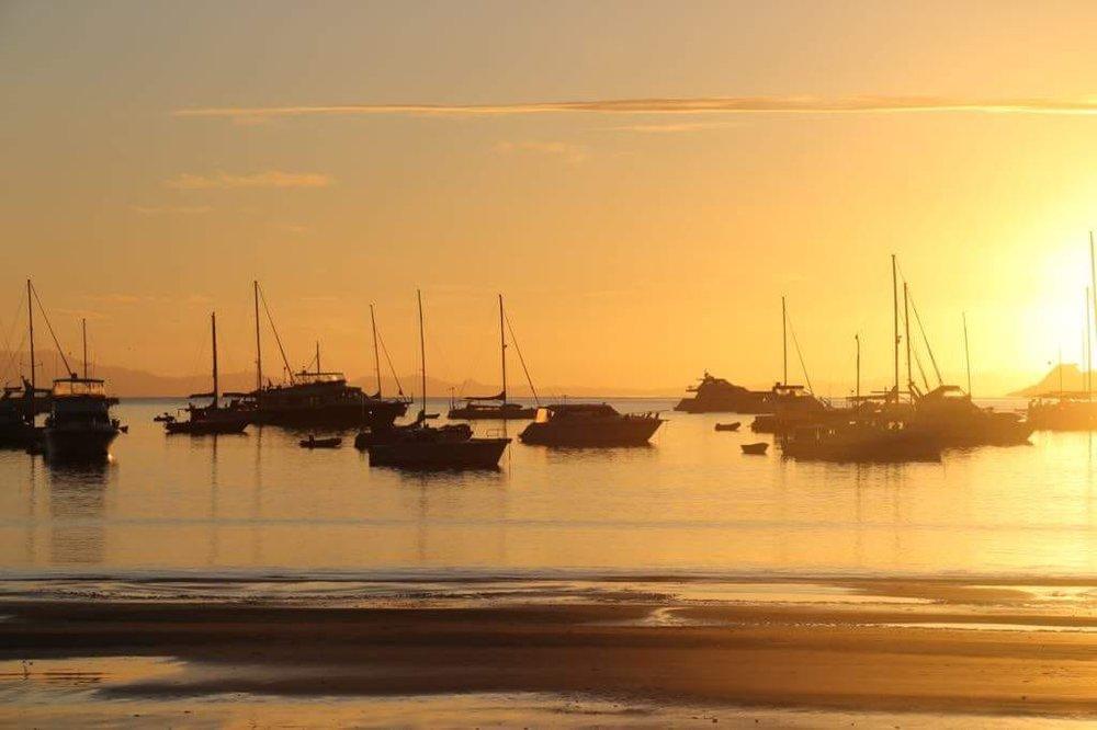 Sailboats Moored at Sunset