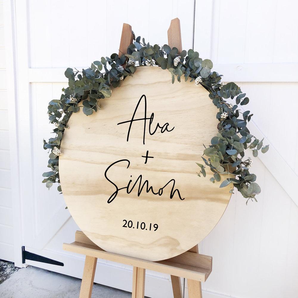 Natural wooden round sign.jpg