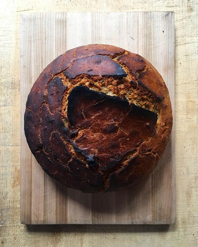 I baked my first loaf of sourdough in the @coleforgestoves oven today. It was a rye-garlic-polenta loaf and it has a nice roasty crust. #coleforgestoves #sourdough