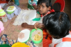 A parent brings in a meal for the whole class everyday. Today they are having stringhoppers made from rice flour