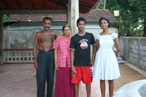 The Gunesekera family outside their new house in Baddegama
