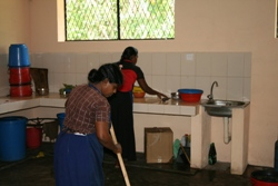 Clearing the new kitchen after the food has been cooked