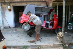 Chanaka repairing a three wheeler