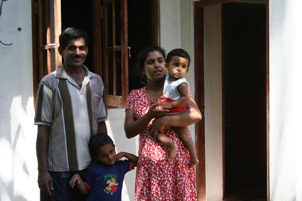 Saman and his family outside the new bakery