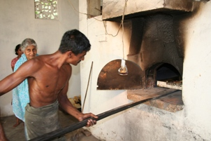 Putting bread into the stone oven