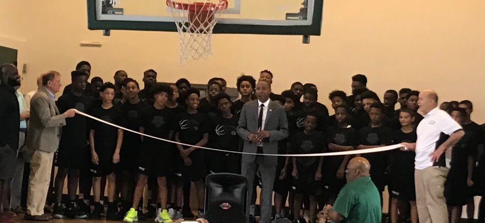 The Basketball Academy inaugural class cutting the ribbon with Assemblyman Holley