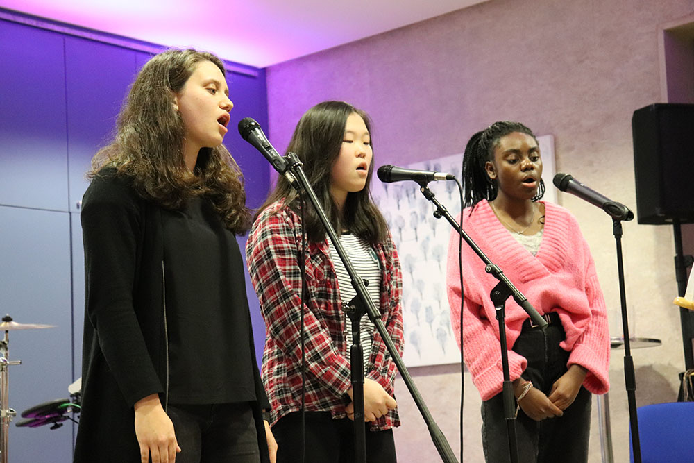 The Blasiantinas—Black, Asian, & Latina—singing 'A thousand years.'