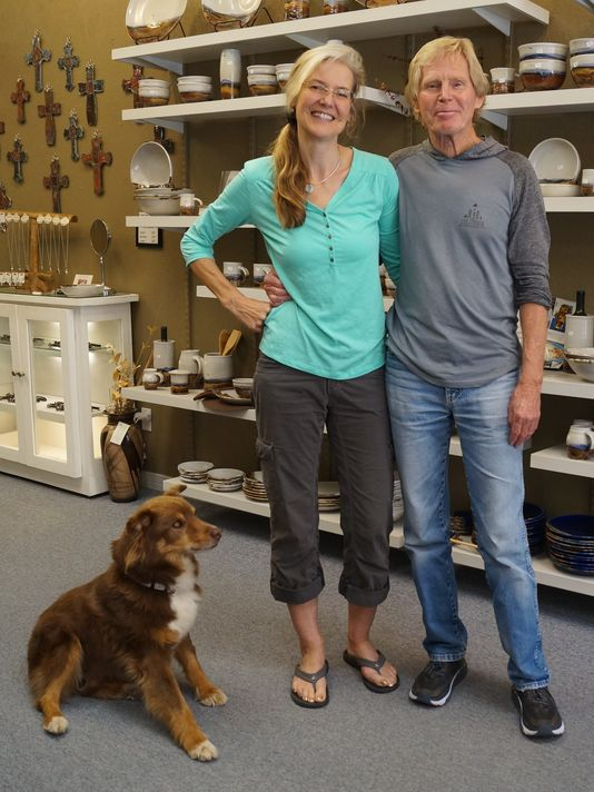 Corinna and Don Zimmerman and their dog Hershey at White Mountain Pottery.