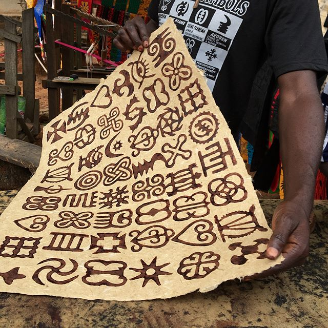 Master Adinkra printer Peter Boakye, experimenting with traditional stamps and ink on Ghanaian handmade paper.