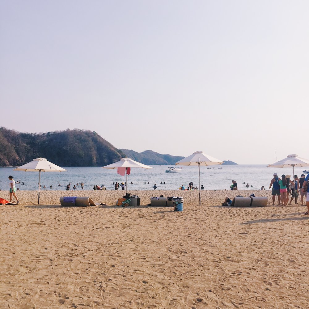 Main beach - We can only stay on this beach because the beach club is exclusive to members and member-accompanied guests only. Since it was summer when we went here, you can see the people from afar.