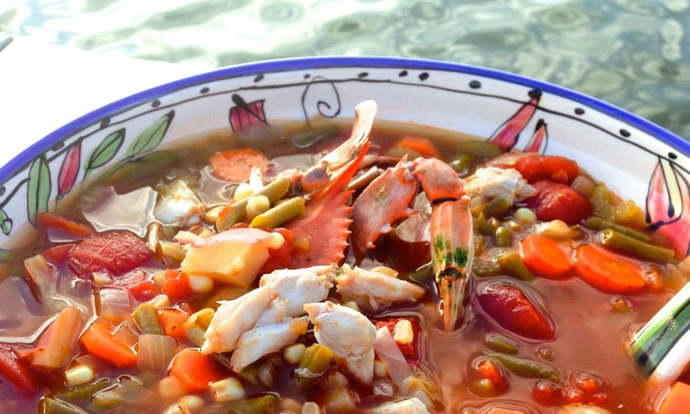 Country Crab Soup - Serves 8 to 105 quarts water2 Knorr chicken bouillon cubes2 Knorr beef bouillon cubes3 cups stewed tomatoes1/4 cup Worcestershire sauce2 tablespoons Old Bay seasoning1/2 teaspoon hot sauce2 bay leaves1 1/2 cups sliced carrots1 1/2 cups thinly sliced celery1 1/2 cups white corn, fresh or frozen1 1/2 cups green beans, fresh or frozen3/4 cup chopped cabbage1 onion, chopped2 cups cubed red potatoes2 pounds jumbo lump crabmeat, any shells removedsalt and pepperBring the water to a boil in a large pot.  Add the bouillon cubes and stir to dissolve.  Add the tomatoes, Worcestershire, Old Bay, hot sauce and bay leaves, stirring to combine.  Simmer for 5 minutes.  Add all vegetables except the potatoes and bring to a boil.  Cook for 10 minutes.Add potatoes and continue to cook until tender.  Add the crabmeat and heat thoroughly.  Avoid stirring too much and breaking up the lumps of meat.Season with salt and pepper.
