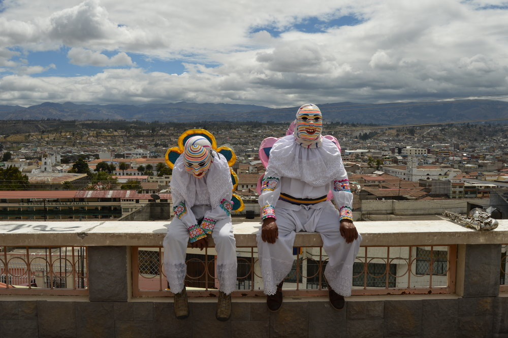 Circa 2016; Latacunga, Ecuador. Two men resting before a day of celebration.